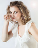 Funny young girl shows a finger Stock Photography
