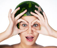 Funny young girl with watermelon as a helmet Royalty Free Stock Images