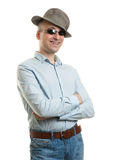 Funny young guy. Wearing a hat and sunglasses on white background Stock Image
