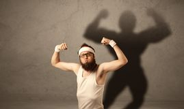 Skinny man with musculous shadow Stock Images