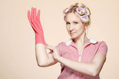 Funny young housewife with gloves Stock Photography