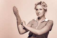 Funny young housewife with gloves Royalty Free Stock Images
