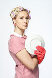 Funny young housewife with gloves  on white background. Royalty Free Stock Photography