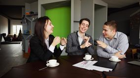 Funny young male and female students give five to each other and royalty free stock photos