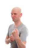 Funny young man with bald head and fist- hands Royalty Free Stock Photography