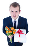 Funny young man with bunch of tulips Royalty Free Stock Photography