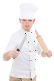 Funny young man in chef uniform with wooden baking rolling pin a Stock Image