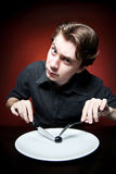 Funny young man eating Stock Image