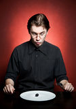 Funny young man eating Royalty Free Stock Images