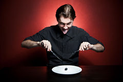 Funny young man eating Royalty Free Stock Image