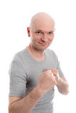 Funny young man with fist- hands Stock Image