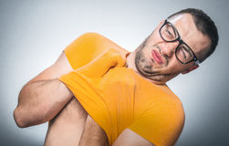 Funny young man get undressing Royalty Free Stock Images