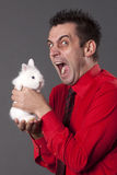 Funny Young Man Holding White Rabbit Stock Photo