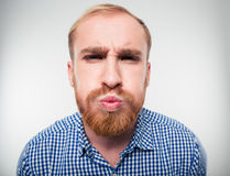 Funny young man inflate his cheeks Royalty Free Stock Photography