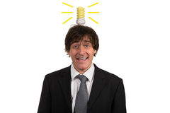 Funny young man with light  bulb over his head, isolated on white background Stock Photos