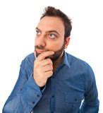 Funny young man looks for an idea Royalty Free Stock Photo