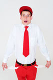 Funny young man showing empty pockets. Over grey background Stock Photography