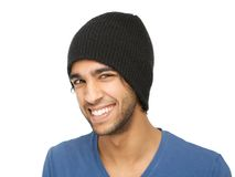 Funny young man smiling with black hat. Close up portrait of a funny young man smiling with black hat isolated on white background Royalty Free Stock Photos