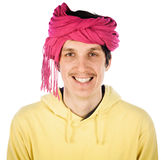 Funny young man in a turban Royalty Free Stock Photo