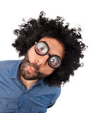 Funny young man with unkempt hair and thick glasses. Royalty Free Stock Photography