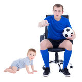Funny young man watching soccer game with little son isolated on Stock Photography