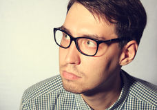 Funny young man wearing glasses Stock Photos