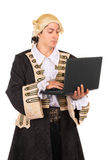 Funny young man. Wearing medieval costume and posing with a laptop. Isolated on white Royalty Free Stock Image
