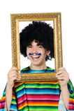 Funny young mexican with photo frame isolated on. The funny young mexican with photo frame isolated on white Royalty Free Stock Photo