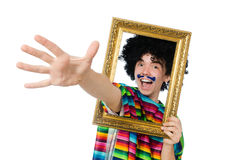 Funny young mexican with photo frame isolated on. The funny young mexican with photo frame isolated on white Stock Image