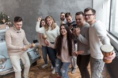 Funny Young People Sing a Song and Dance. Christmas concept stock photos