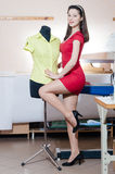 Funny young pinup woman with mannequin happy smiling & looking at camera Royalty Free Stock Photos