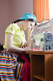 Funny young pinup woman with sewing machine Royalty Free Stock Photo
