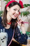 Funny young pinup woman with sewing machine and measuring tape happy smiling & looking at camera closeup portrait Stock Photos