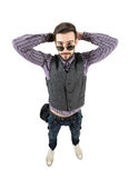 Funny young relaxed hipster with hands behind head Royalty Free Stock Image