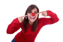Funny young santa woman with ribbon in her nose Royalty Free Stock Images