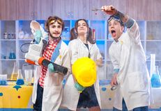 Funny young scientists in lab together. Funny young scientists making experiment in the laboratory together Stock Photos