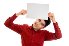 Funny young stylish man in red shirt posing with empty placard in his hands and looking up isolated on white background Royalty Free Stock Images