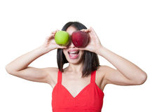 Funny young woman with apples over eyes isolated Stock Photography