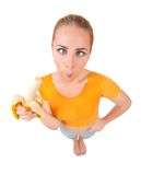 Funny young woman with banana Stock Photo