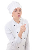 Funny young woman in chef uniform singing with corolla isolated Royalty Free Stock Images