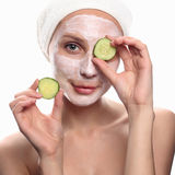 Funny young woman with cucumber mask Royalty Free Stock Photos