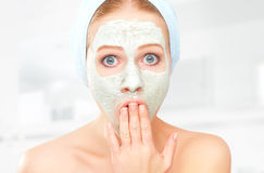 Funny young woman and facial skin care mask Royalty Free Stock Image