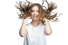 Funny young woman with flying hair Royalty Free Stock Photos