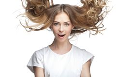 Funny young woman with flying hair Royalty Free Stock Images