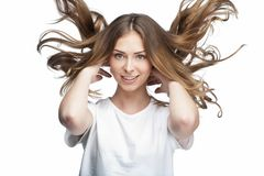 Funny young woman with flying hair Royalty Free Stock Photography