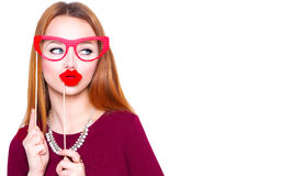Funny young woman holding paper glasses and red lips Royalty Free Stock Photography