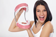Funny young woman with jaws Royalty Free Stock Images
