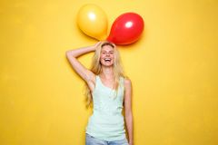 Funny young woman laughing with balloons Royalty Free Stock Photo