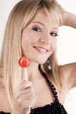 Funny young woman with a lollipop Royalty Free Stock Photo
