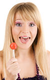 Funny young woman with a lollipop Stock Photo